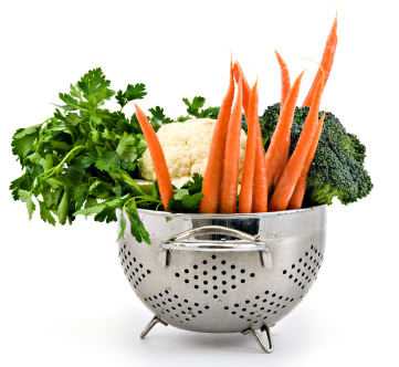 Fresh Vegetables in a Colander, Carrots, Broccoli, Cauliflower and Cilantro