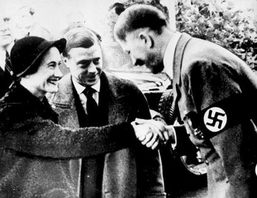 Picture dated 23 October 1937 of the Duke of Windsor (C), the great great uncle of Prince Harry, and his wife Wallis Simpson meeting the German Chancellor Adolf Hitler. Prince Harry has apologised after being pictured in a Nazi uniform at a fancy dress party. The Sun's front page showed the Prince, with a cigarette and drink in hand, wearing a swastika armband