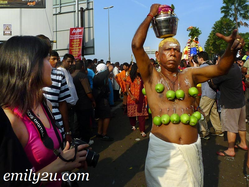 Thaipusam devotee with milk pot on head