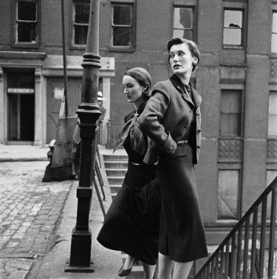 Photographed by Genevieve Naylor wearing a Hockanum tweed coat and Evelyn Tripp wears a dress coat designed by I Doctor 1950