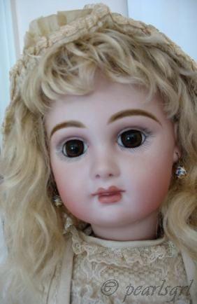 Antique bisque doll Jumeau reproduction
