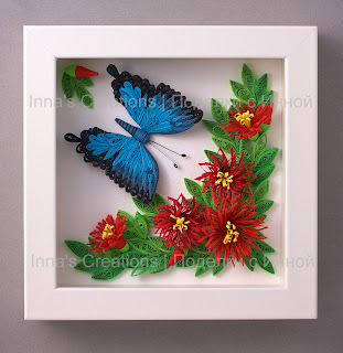 Framed butterfly and flowers. Paper filigree (quilling)
