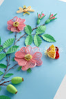 Quilled dog-rose flowers, hips, moth, and butterfly