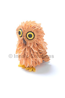 Quilled baby owl, side view