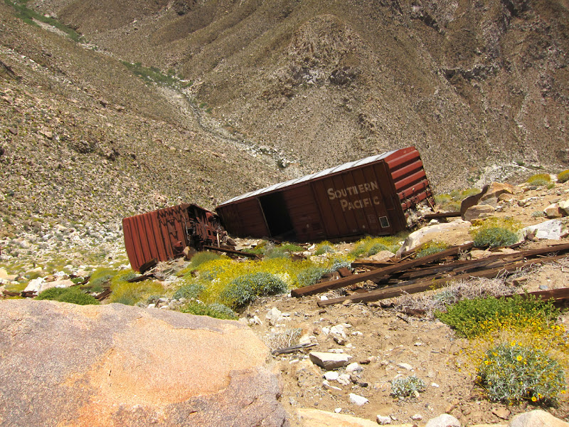 Old box cars that were apparently pushed off the Carrizo Gorge railway