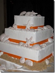 Orange Ribbon Tropical Themed Wedding Cakes with Shells and Starfish