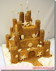 The Ultimate Sandcastle Beach Wedding Cake with Shell and Starfish Decorations