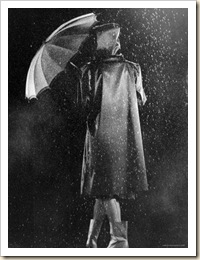 1270402~Fashion-Shot-of-Model-in-Raincoat-Umbrella-and-Galoshes-Poster