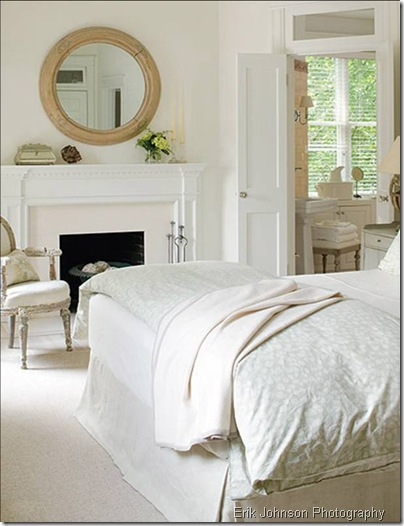 erik johnson bedroom white bed linens louis armchair chair fireplace mantel natural wood round mirror carpet rug box pleat skirt