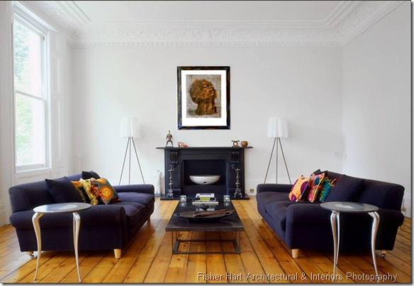 fisher hart photography white living room modern belsize park london carved crown molding two dark blue sofas black fireplace mantel