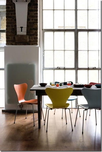 Dining room loft style floor to ceiling windows rustic table colourful Arne Jacobsen designer chairs 3107 series 7 chair wood flooring L etc 03/2007 pub orig