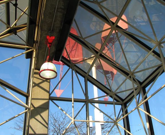 the view from inside Porter Square T station, looking at the red windmill sculpture