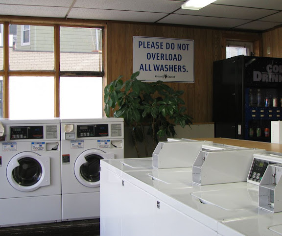 laundromat sign: 'please do not overload all washers'