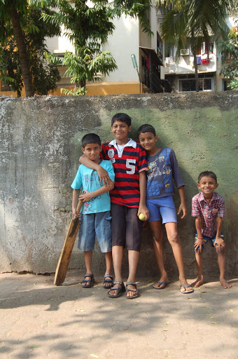 Children playing Cricket In the Street in Mumbai