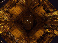 Date: december 2007</p> <p>Location: Paris</p> <p>Story: We finally made it to see the Eiffel Tower. Devin had not seen this structure before. We got there in the evening. It was a dreary night. Devin decided that we should take a picture of the tower from the bottom.  I set up the tripod and obliged. One of the more remarkable pictures in my collection.