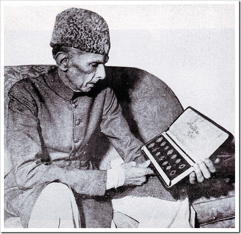 Quaid-e-Azam examines the first set of coins in Pakistan