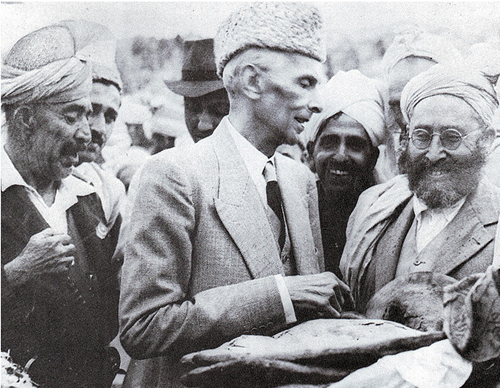 Quaid-e-Azam accepting a loaf of bread from tribesmen in Khyber Agency