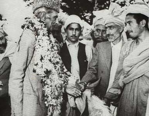 As a gesture of goodwill, tribal leaders presenting a goat to the Quaid