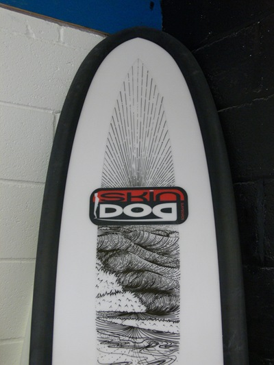 Tim Stafford custom pen artwork on SkinDog surfboard