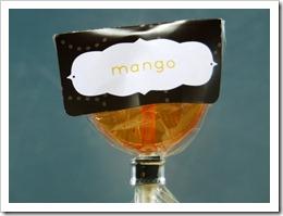 mango lollipop in a charcoal gray wrapper