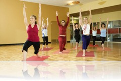 Adult females in yoga class.
