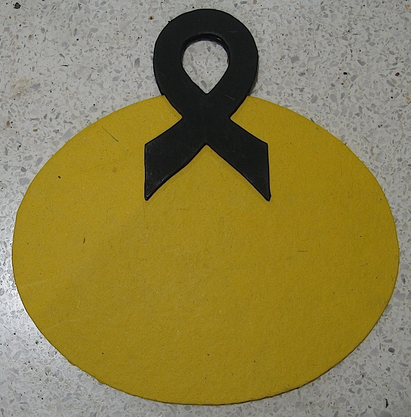 yellow fan with ribbon