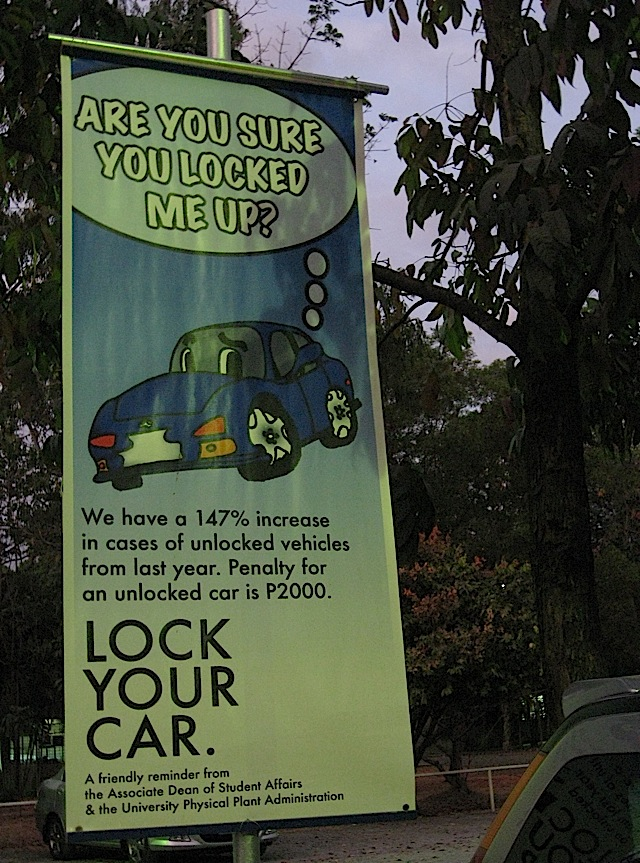 banner reminding students to lock their cars