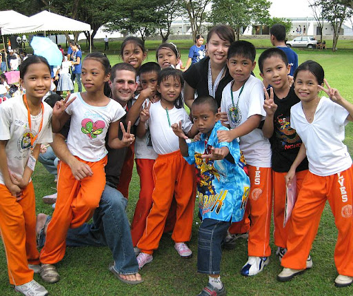 Up with People participants with children from the Leodegario Victorino Elementary School