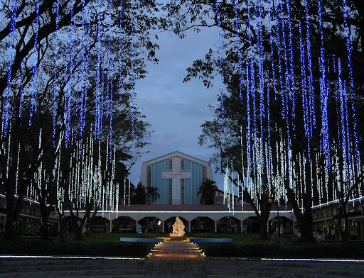 The Promenade of Our Lady and St. Stanislaus Kostka Chapel at the Ateneo de Manila High School at dusk