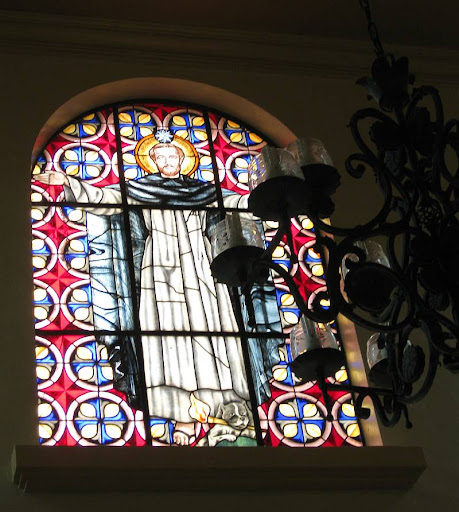 stained glass window featuring St. Dominic in the main entrance hall of Caleruega in Batangas