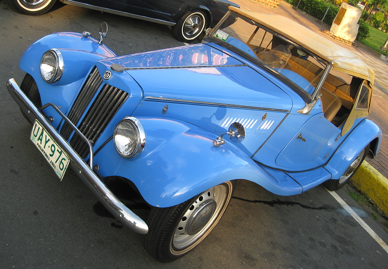 light blue convertible MG