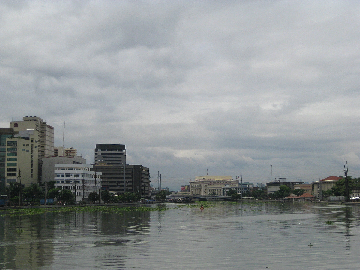 Pasig River with a view of Binondo, Jones Bridge and the Manila Central Post Office