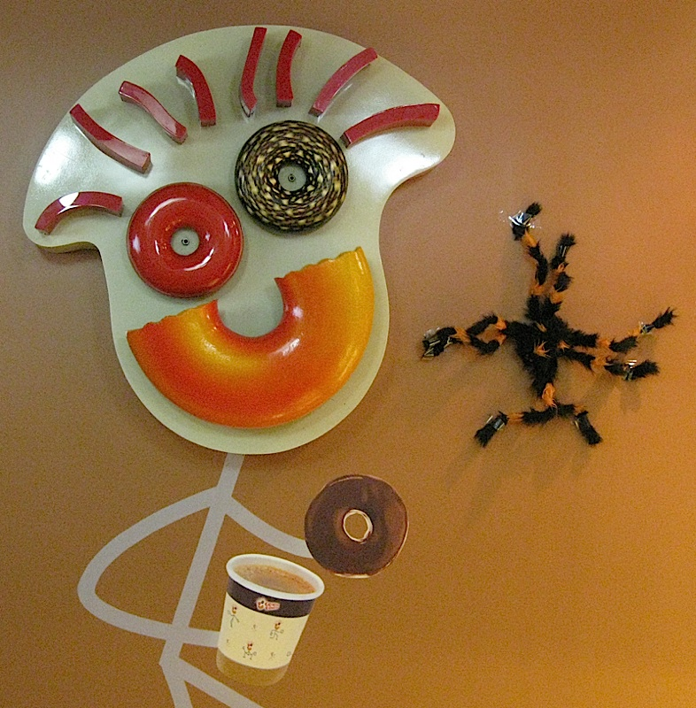 Go Nuts Donuts mascot with Halloween spider
