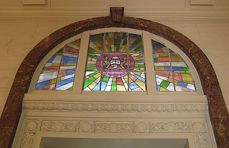 arched stained glass window over a door at the Museum of the Filipino People