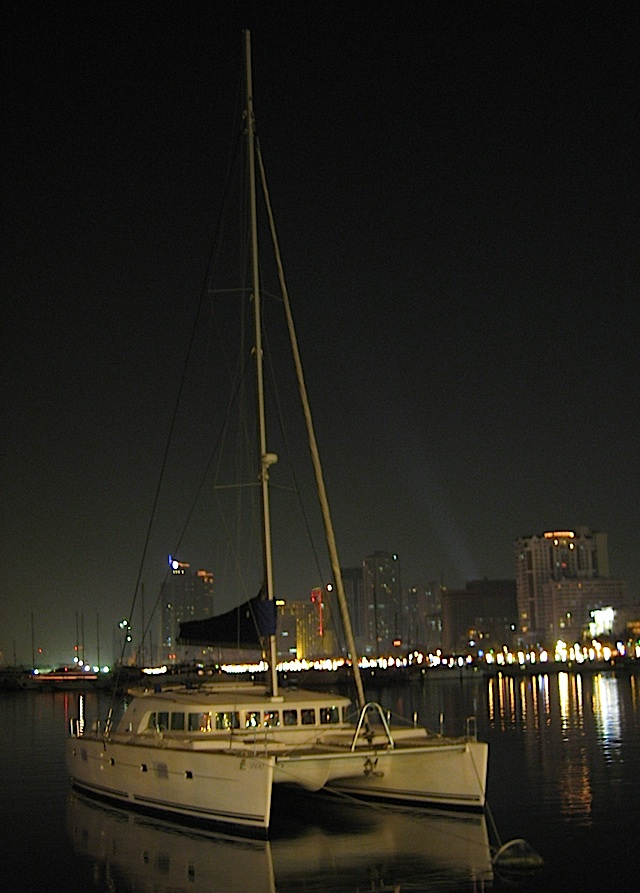 a catamaran docked in Manila Bay