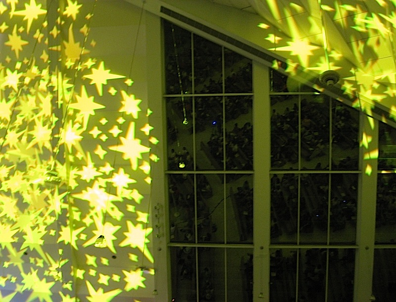 yellow star-shaped lights in the Church of the Gesù during the Festival of Ateneo Music