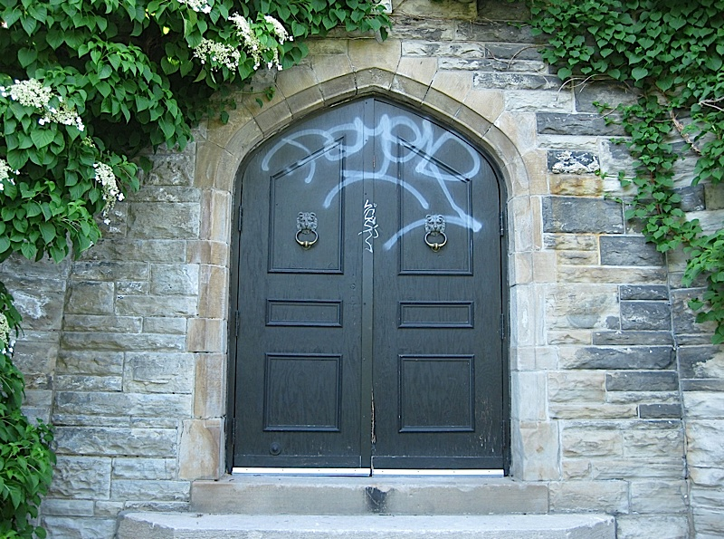 graffiti on a garden door of Casa Loma