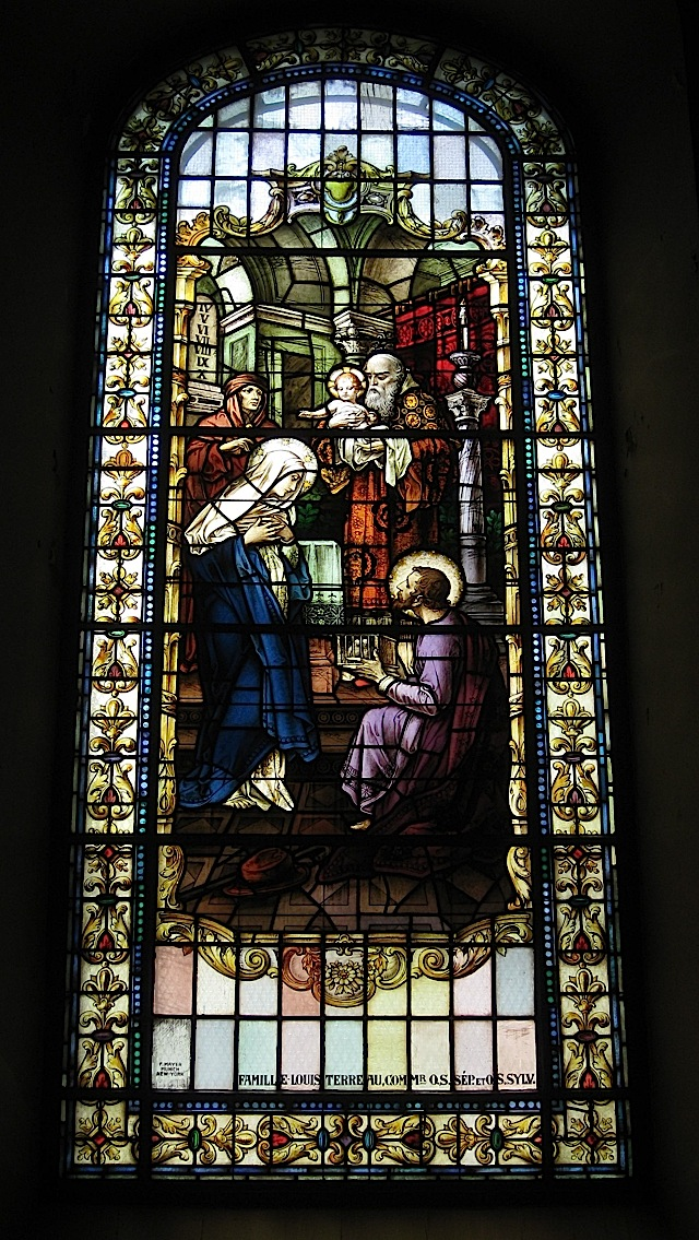 stained glass window at the Notre-Dame de Québec depicting the presentation of Jesus at the temple