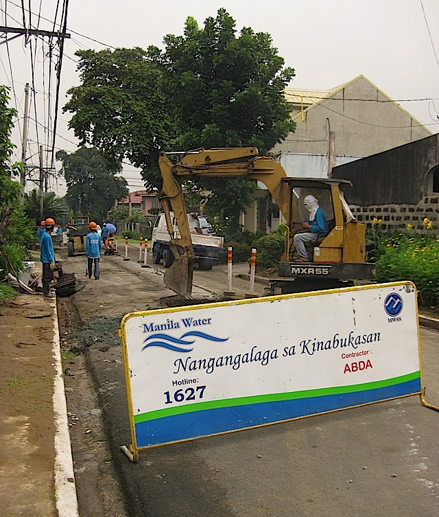 Manila Water digging a road for a sewer