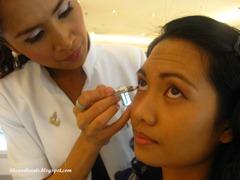 baby applying eye liner, by bitsandtreats