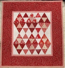 red and white miniature quilt 1