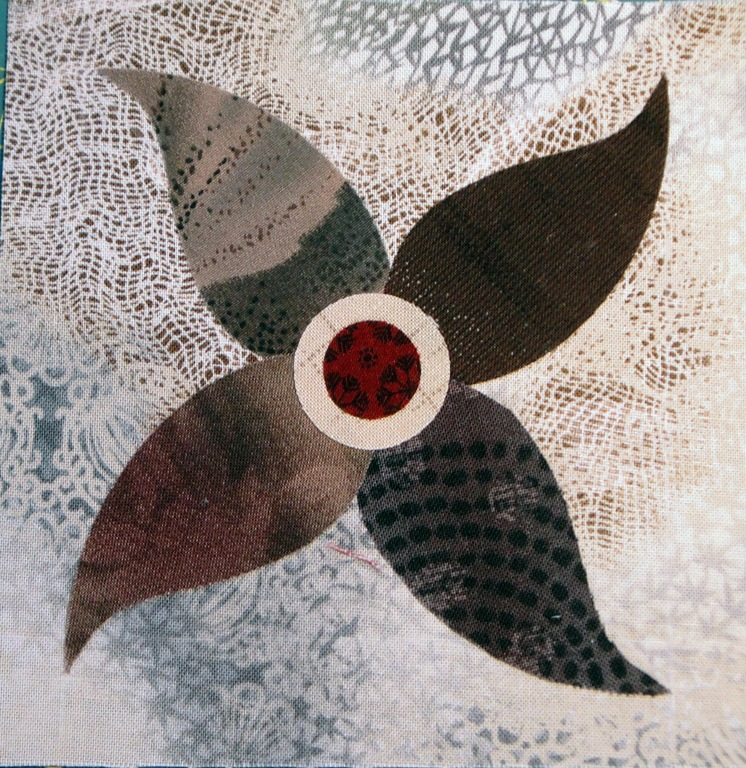 [taupe round flower spin[3].jpg]