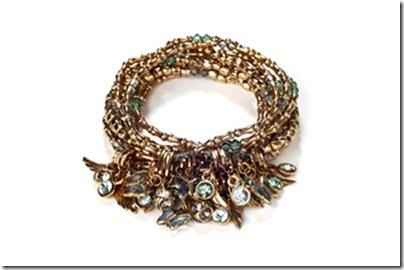 Estela Geromini - Jogo de pulseiras de metal e cristais com berloques de cristais swarovski, murano e pingentes em banho de ouro rose envelhecido - R$ 207 bx