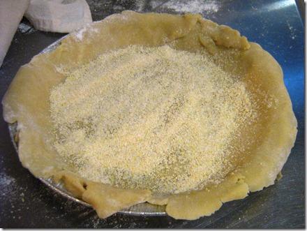 Espolvorea con pan molido o corn meal