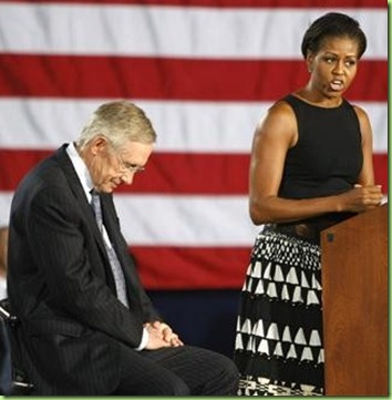 50760-u-s-senator-harry-reid-looks-at-the-floor-as-first-lady-mich