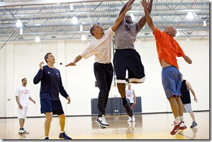 President Barack Obama attempts to block a shot by personal aide Reggie Love, during a basketball game at Fort McNair in Washington, D.C. , May 16, 2010. Secretary of Education Arne Duncan, left, watches the play. (Official White House Photo by Pete Souza)
