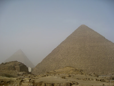 Pyramids of Giza in the morning fog