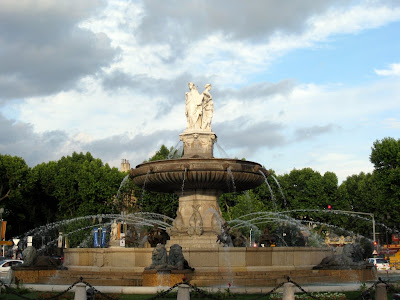 Huge city fountain in a roundabout in Aix en Provence