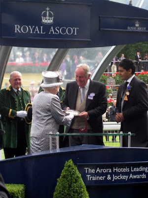 Queen getting a trophy at Royal Ascot