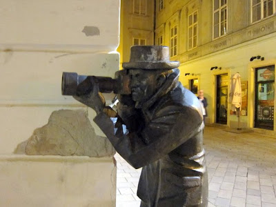 Sculpture of a man with a camera in Bratislava Slovakia